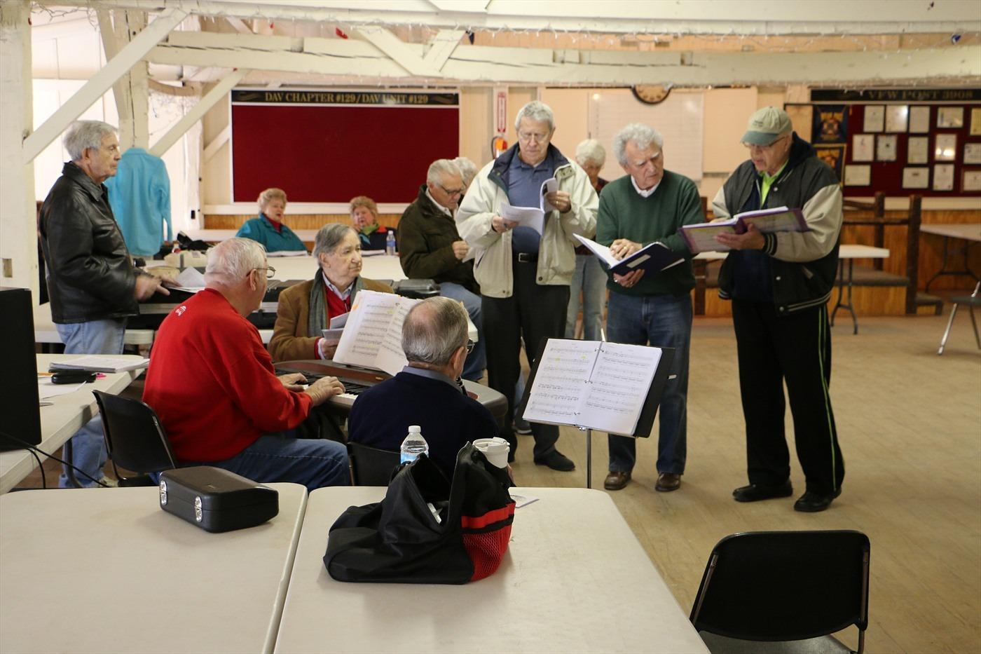 men rehearsing music