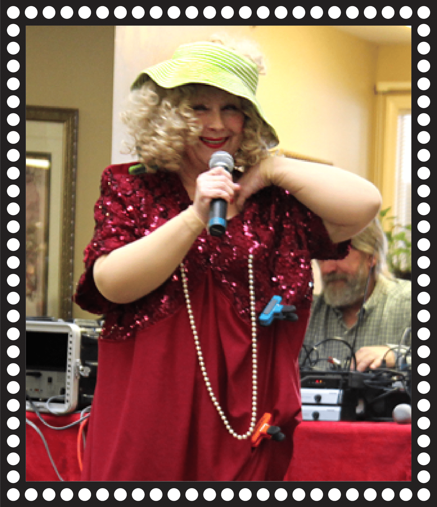Woman performing with mircrophone and hat facing left