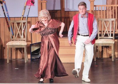 Man and woman dancing - Heart of the Hills Players Something's Afoot Performance 2018