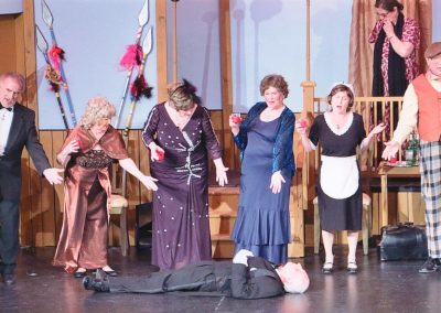 Man in tux dead on floor - Heart of the Hills Players Something's Afoot Performance 2018